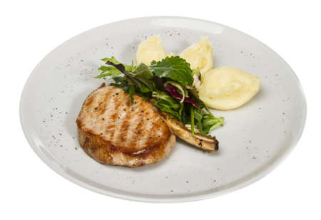 Grilled pork with salad and potato photo