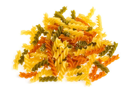 Uncooked pasta fusilli in different colours, white background Stock Photo - 16100864