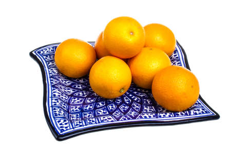 Heap of oranges in the dish photo