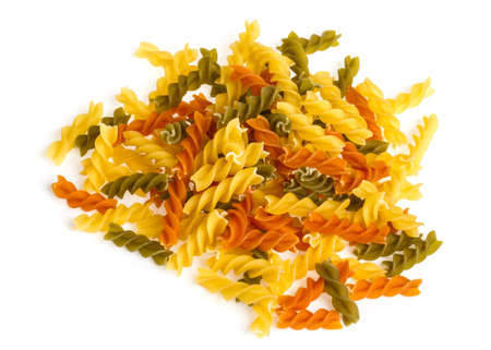 Uncooked pasta fusilli in different colours, white background Stock Photo - 16189845