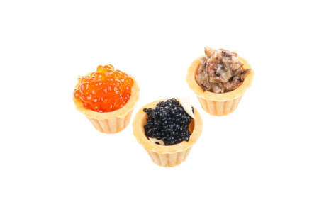 Canapes with red, black and mushroom caviar photo