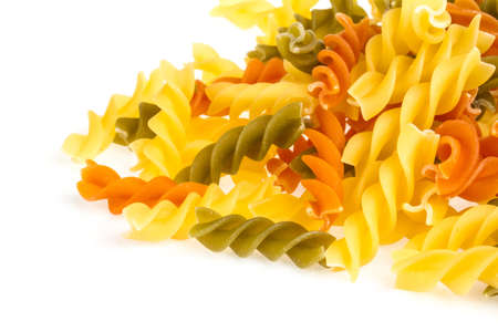 Uncooked pasta fusilli in different colours, white background Stock Photo - 16328724