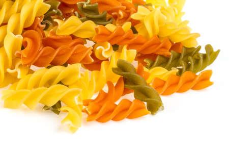 Uncooked pasta fusilli in different colours, white background Stock Photo - 16622075