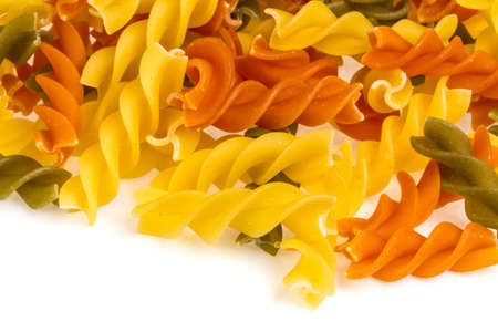 Uncooked pasta fusilli in different colours, white background Stock Photo - 16622187
