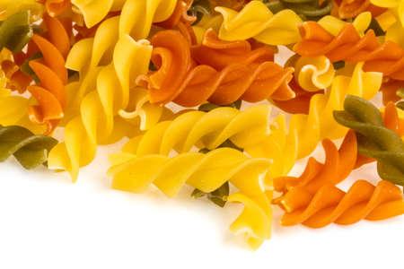 Uncooked pasta fusilli in different colours, white background Stock Photo - 16622187