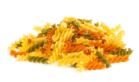 Uncooked pasta fusilli in different colours, white background Stock Photo - 16620054