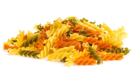 Uncooked pasta fusilli in different colours, white background Stock Photo - 16620230