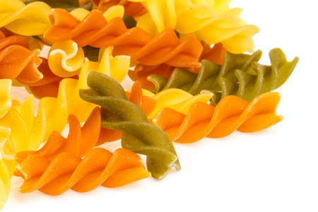 Uncooked pasta fusilli in different colours, white background Stock Photo - 16622124
