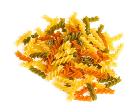Uncooked pasta fusilli in different colours, white background Stock Photo - 16620495