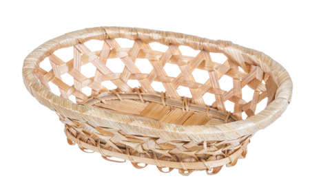 Wickerwork empty yellow breadbasket on white background Stock Photo - 16626569