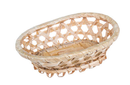 Wickerwork empty yellow breadbasket on white background photo