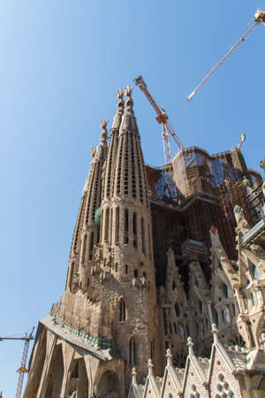 BARCELONA, SPAIN -JUNE 25: Sagrada Familia on JUNE 25, 2012: La Sagrada Familia - the impressive cathedral designed by architect Gaudi, which is being build since March 19, 1882 and is not finished yet.
