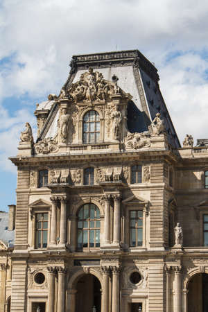 consistently: PARIS - JUNE 7: Louvre building on June 7, 2012 in Louvre Museum, Paris, France. With 8.5m annual visitors, Louvre is consistently the most visited museum worldwide. Editorial