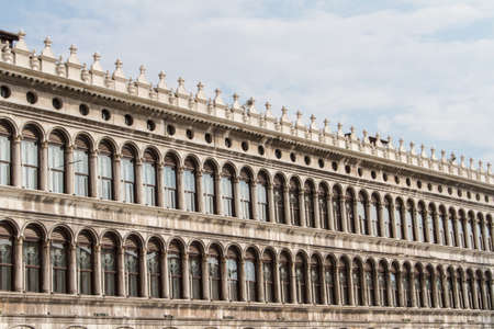 procuratie: A fragment of the building of the Old Procuratie at the Piazza San Marco in Venice Stock Photo
