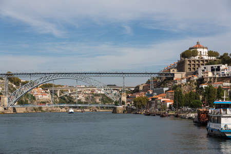 View of Porto city at the riverbank (Ribeira quarter) and wine boats(Rabelo) on River Douro(Portugal), a UNESCO World Heritage City. Stock Photo - 16713594