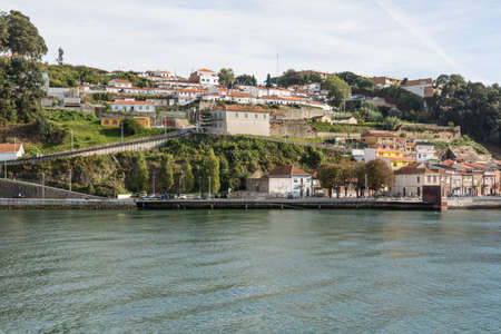 View of Porto city at the riverbank (Ribeira quarter) and wine boats(Rabelo) on River Douro(Portugal), a UNESCO World Heritage City. Stock Photo - 16713487
