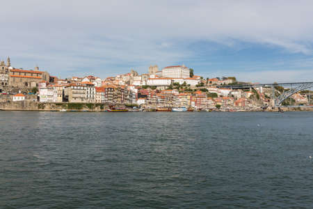 View of Porto city at the riverbank (Ribeira quarter) and wine boats(Rabelo) on River Douro(Portugal), a UNESCO World Heritage City. Stock Photo - 16804542