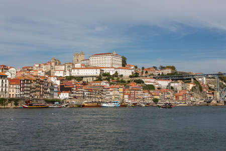 View of Porto city at the riverbank (Ribeira quarter) and wine boats(Rabelo) on River Douro(Portugal), a UNESCO World Heritage City. Stock Photo - 16806432