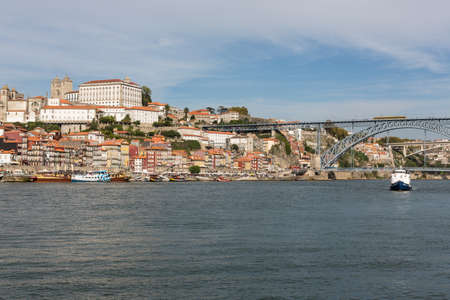 View of Porto city at the riverbank (Ribeira quarter) and wine boats(Rabelo) on River Douro(Portugal), a UNESCO World Heritage City. Stock Photo - 16807279