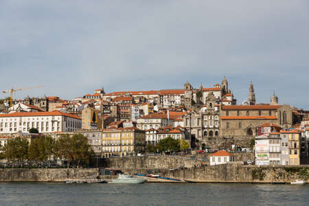View of Porto city at the riverbank (Ribeira quarter) and wine boats(Rabelo) on River Douro(Portugal), a UNESCO World Heritage City. Stock Photo - 16806623