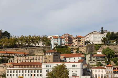 View of Porto city at the riverbank (Ribeira quarter) and wine boats(Rabelo) on River Douro(Portugal), a UNESCO World Heritage City. Stock Photo - 16804546