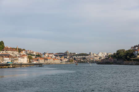 View of Porto city at the riverbank (Ribeira quarter) and wine boats(Rabelo) on River Douro(Portugal), a UNESCO World Heritage City. Stock Photo - 16780949