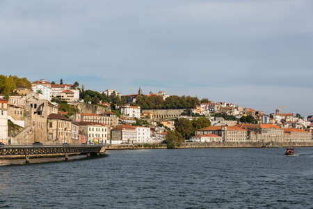 View of Porto city at the riverbank (Ribeira quarter) and wine boats(Rabelo) on River Douro(Portugal), a UNESCO World Heritage City. Stock Photo - 16804376