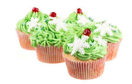 Studio isolated creamy green cupcake photo