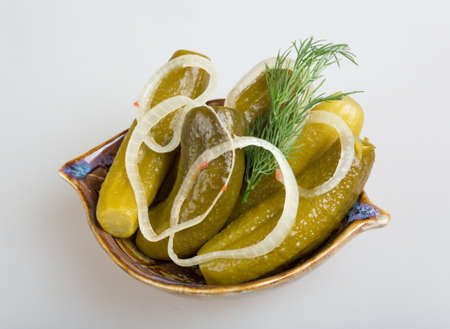 Closeup view of pickled cucmbers in a bowl photo