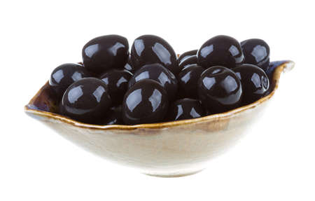 Olives black watered with olive oil in a bowl isolated on a white background photo
