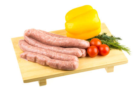 raw sausages and ingredients photo