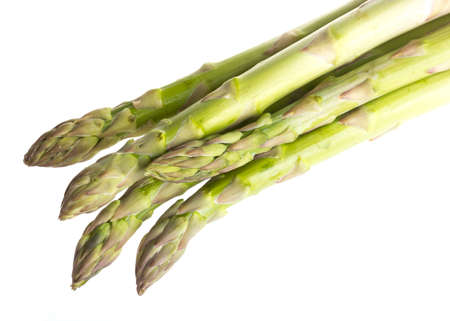 fresh asparagus spears isolated on white photo