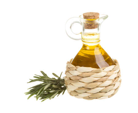 Bottle of sunflower oil with branch rosemary photo