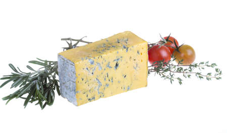 Slice of Roquefort cheese with tomato and herbs photo