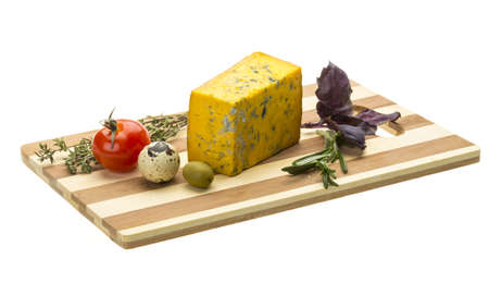 Yellow cheese with blue mold photo