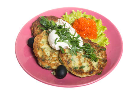 Roasted cutlets of potato with salmon on a plate photo