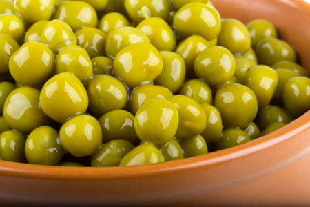 green peas, in a bowl, isolated, white background Stock Photo - 17406889