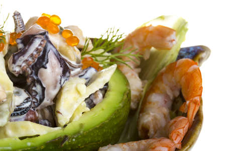 Seafood salad with red caviar in avocado photo