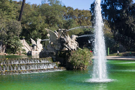 Barcelona ciudadela park lake fountain with golden quadriga of Aurora photo