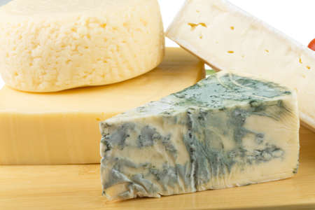 Variety of cheese: ementaler, gouda, Danish blue soft cheese and other hard cheeses Stock Photo - 17489515