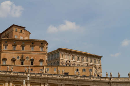 Buildings in Vatican, the Holy See within Rome, Italy. Part of Saint Peters Basilica. photo