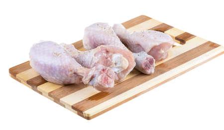 Close up of fresh raw chicken legs photo