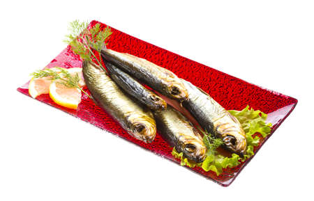 sprat: Smoked sprat - appetizing snack Stock Photo