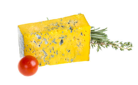 roquefort: Slice of Roquefort cheese with tomato and herbs