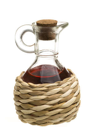 decanter: Small decanter with red wine vinegar isolated on the white Stock Photo