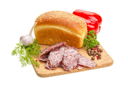 Fresh ripe salami with bread and vegetables photo