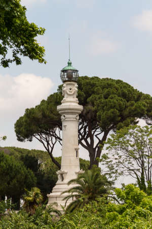 small lighthouse between the trees in Rome, Italy photo