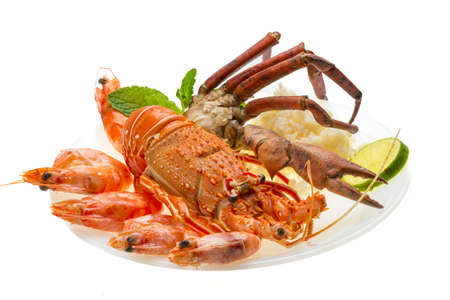 Spiny lobster, shrimps, crab legs  and rice