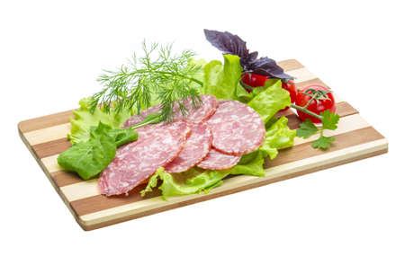 Sausages with salad and basil photo