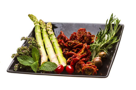 Dried tomato with asparagus and herbs photo
